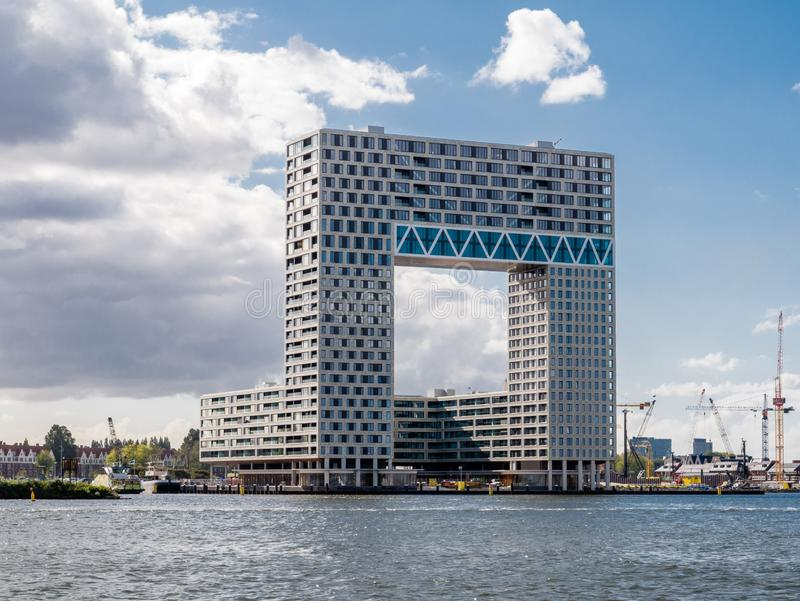 Modern apartment building Pontsteiger on south bank of river IJ, Amsterdam, Netherlands royalty free stock photography
