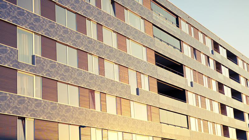 A modern apartment building at sunset stock image