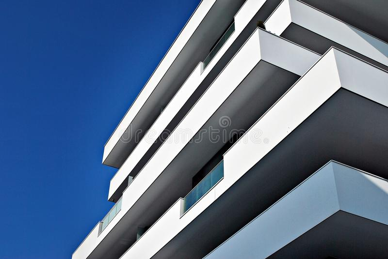 Modern apartment buildings exteriors. Facade of a modern apartment building. Architectural details of modern apartment building.Abstract closeup of the glass royalty free stock photography