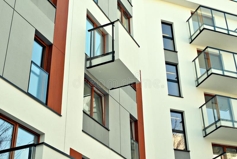 Modern apartment buildings exteriors. Facade of a modern apartment building. Architectural details of modern apartment building.Abstract closeup of the glass royalty free stock photo