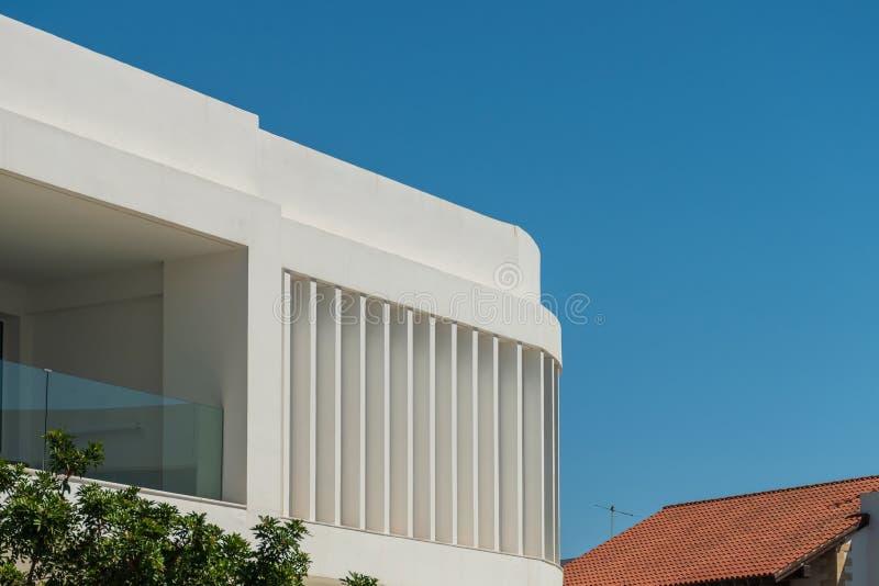 Modern apartment buildings on a sunny day with a blue sky. Facade of a modern apartment building. White apartment buildings on a sunny day with a blue sky stock photos