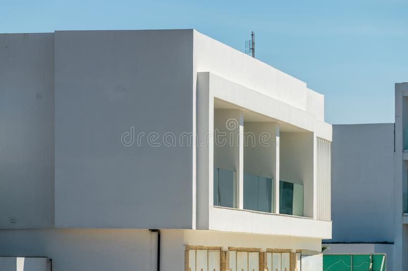 Modern apartment buildings on a sunny day with a blue sky. Facade of a modern apartment building. White apartment buildings on a sunny day with a blue sky stock photo