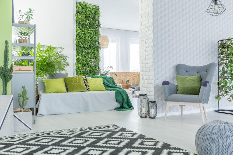 Modern apartment with 3d wallpaper. Sofa, armchair and pouf stock photo
