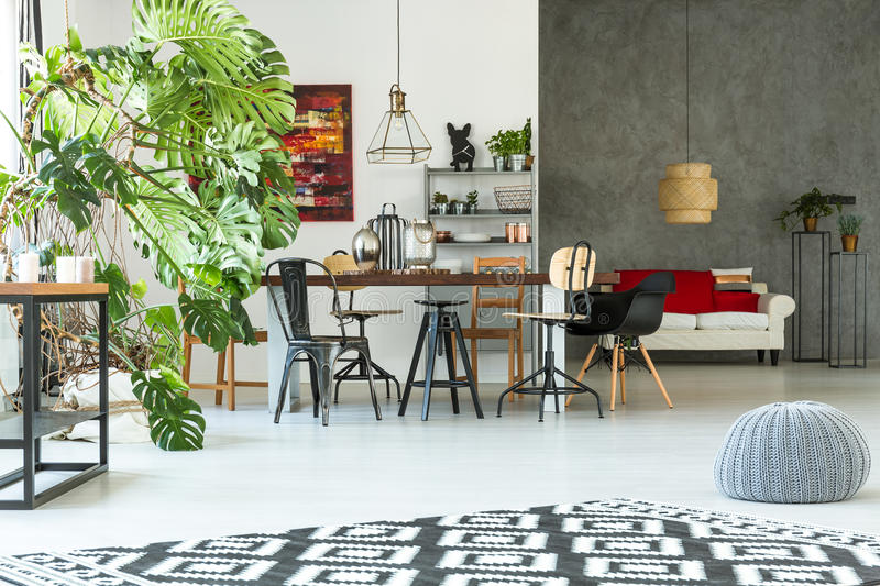 Modern apartment with dining table stock photography