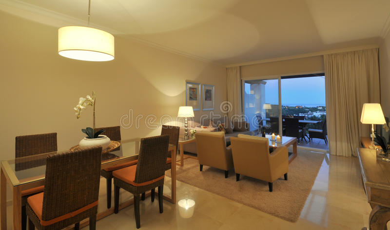 Modern apartment interior. Looking through the lounge to a large terrace stock photo