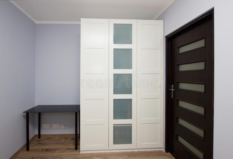 Modern apartment interior with wardrobe royalty free stock photos