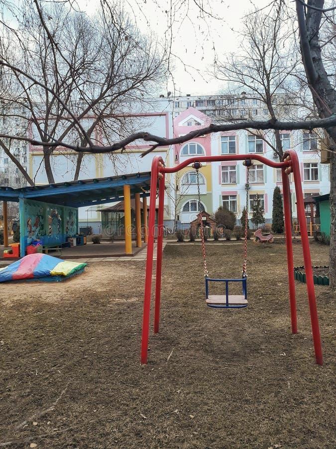 Modern apartment kindergarten with empty kids playground royalty free stock image