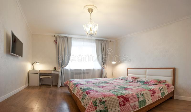 Modern apartment in soft warm colors, interior, bedroom. royalty free stock photography