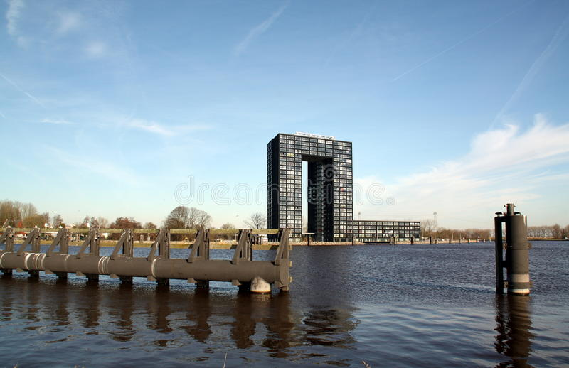 Modern apartments building and mooring posts royalty free stock photography