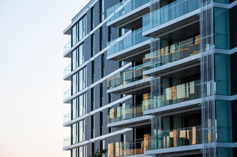 Modern apartments. Outside view of modern apartments with glass terraces stock images