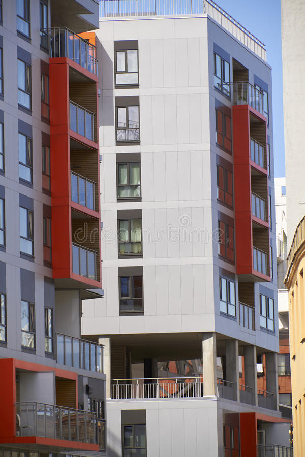 Modern appartement buildings. Modern appartment buildings with red details on the facade royalty free stock photo