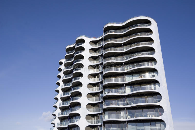 Modern appartment tower. Modern curved appartment tower in Copenhagen, Denmark. Each appartment has it's own unique balconny royalty free stock image