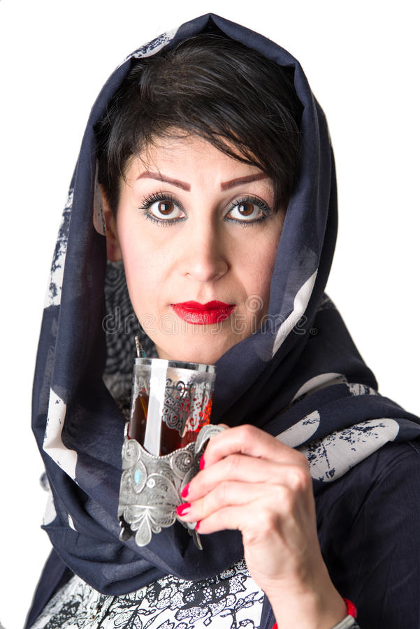 Modern arabian woman with a cup of tea royalty free stock photo