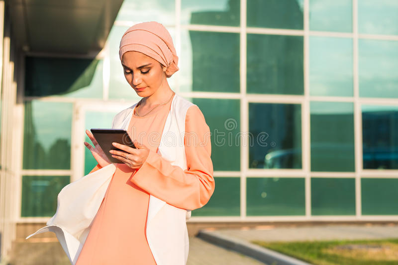 Modern Arabian woman with tablet computer stock image