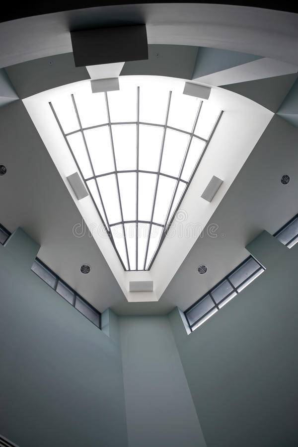 Modern Architectural Interior. A modern architectural interior with a triangular shaped skylight royalty free stock images