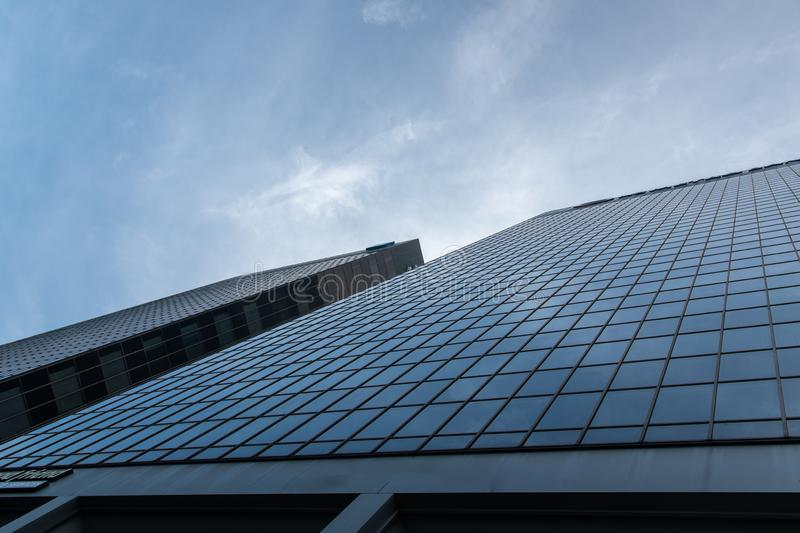 Modern architecture against the blue sky. A modern glass building seen from below, rising up into the deep blue skies stock photos