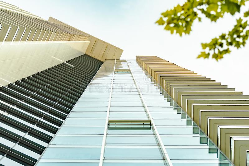 Modern architecture commercial skyscraper building. Ground level view of modern architecture commercial building, concrete and glass walls royalty free stock images