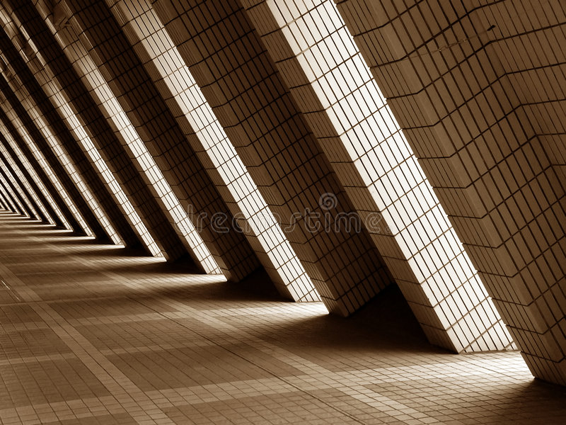 Modern Architecture Design. Sepia colored modern architecture design with diagonal shadow play royalty free stock photography