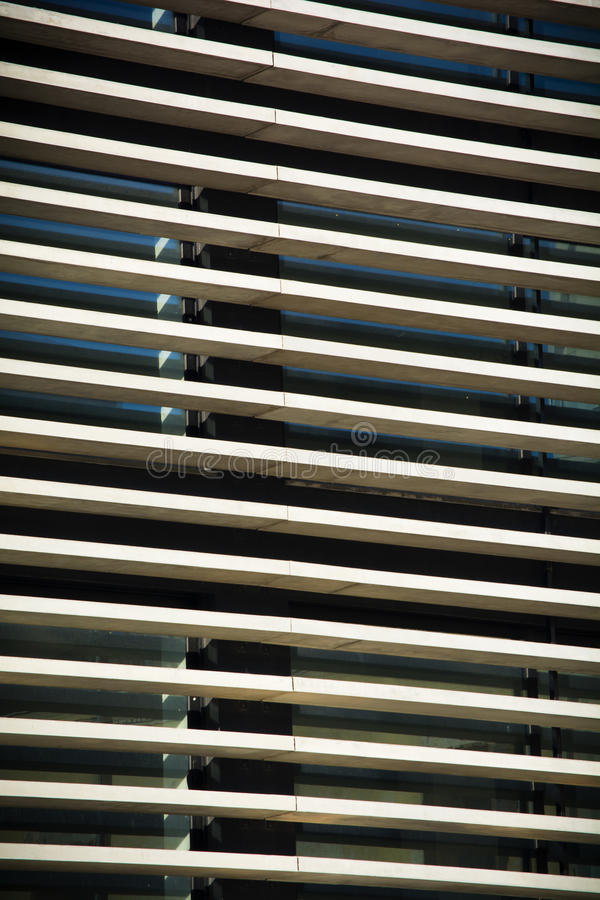 Modern architecture. Detail of minimal modern architecture windows. Lines of cement & glass royalty free stock images