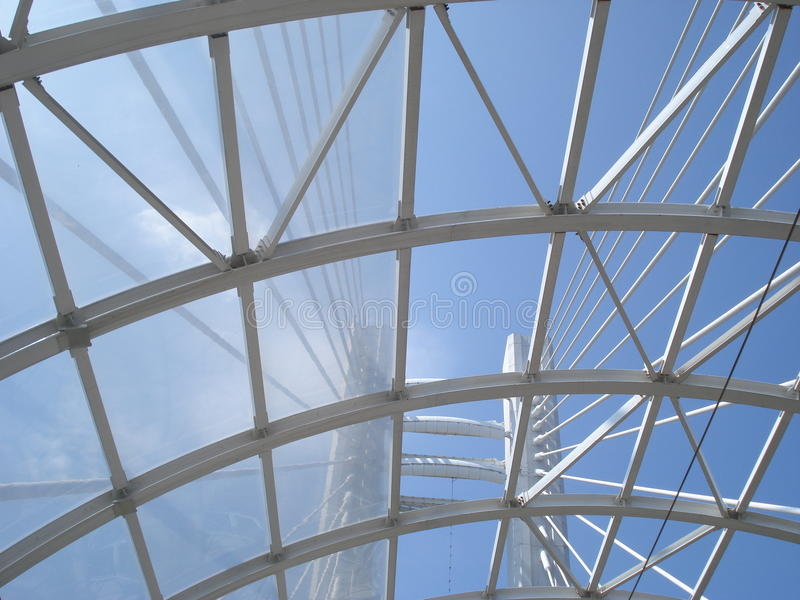 Modern architecture details. Towers and suspension wires seen through tram station roof on Basarab overpass in Bucharest royalty free stock photos
