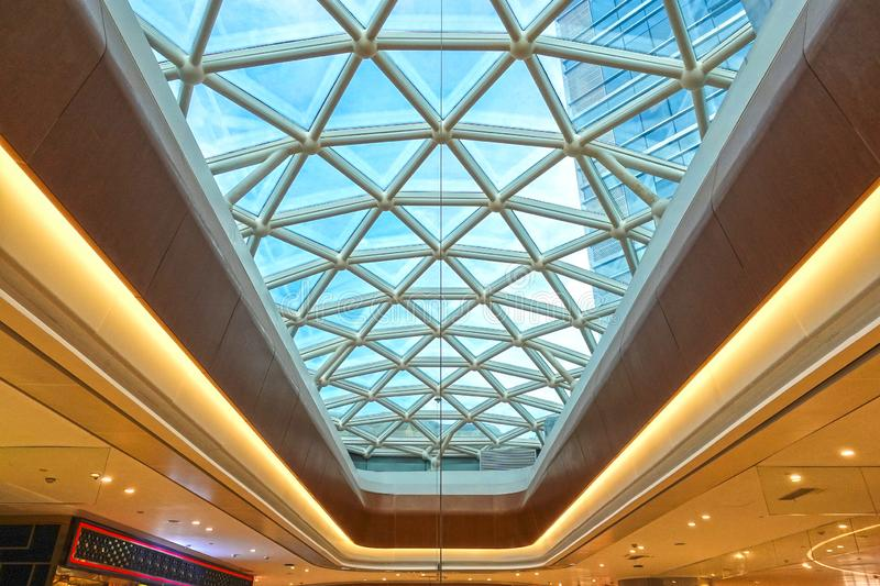 Modern architecture glass roof structure construction site. Modern business architecture with steel construction and glass roof structure stock image