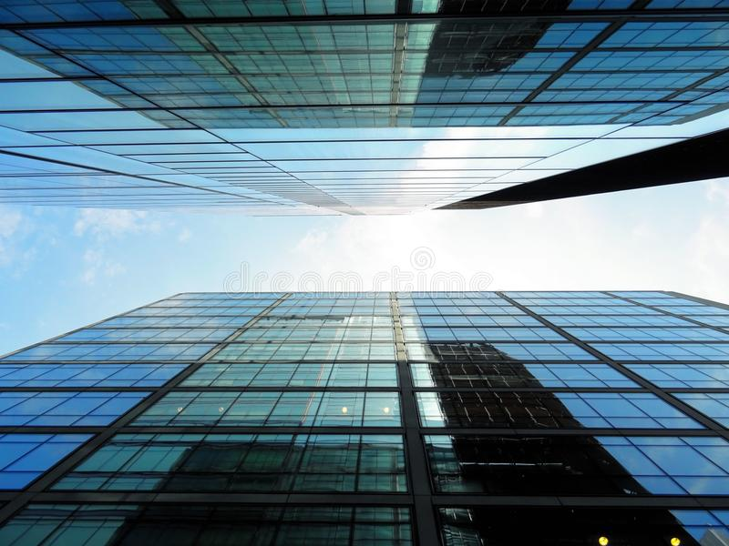 Modern architecture from low angle against blue skies royalty free stock photography