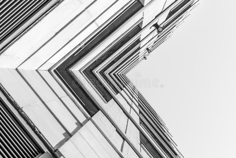 Modern architecture, minimal design and art. Urban Geometry, looking up to glass building. Modern architecture, glass and steel. . Abstract architectural design royalty free stock photos