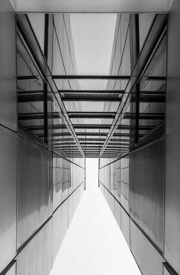 Modern architecture, minimal design and art. Urban Geometry, looking up to glass building. Modern architecture, glass and steel. Abstract architectural design royalty free stock photography