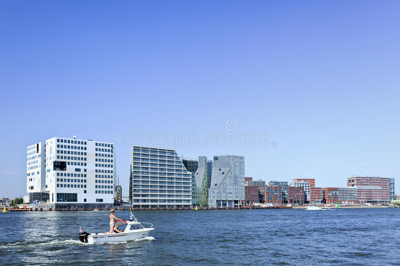 Modern architecture near canal in Amsterdam stock images