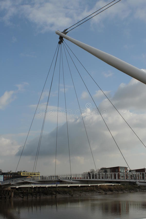 Modern architecture river bridge. Modern suspension bridge for pedestrians spans the River Usk in Newport City Centre, South Wales - host city for the upcoming stock image