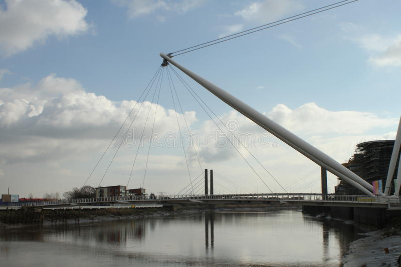 Modern architecture river bridge. Modern suspension bridge for pedestrians spans the River Usk in Newport City Centre, South Wales - host city for the upcoming royalty free stock photos