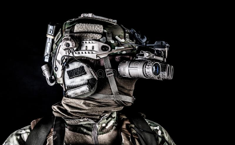 Soldier in night view goggles low key studio shoot royalty free stock image