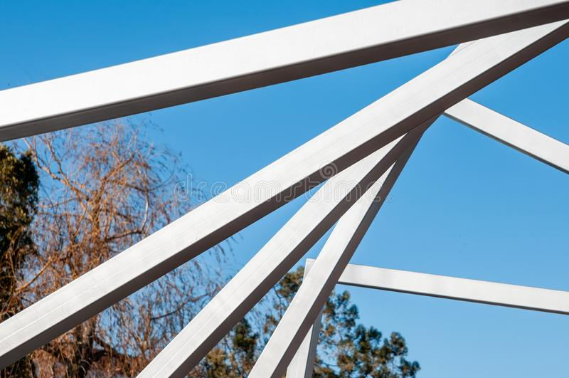 Metal art Line in the park. Sunny day, installation Modern Art, metal arcs in the park, province stock photos