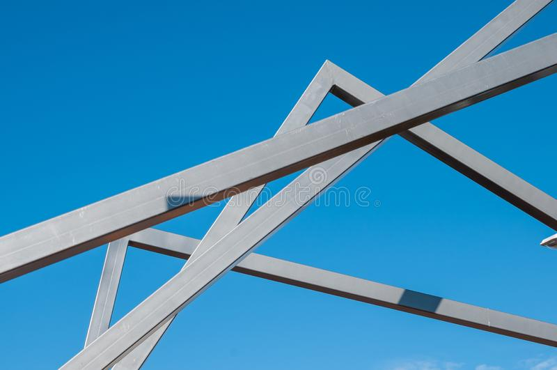 Metal art Line in the park. Sunny day, installation Modern Art, metal arcs in the park, province stock images