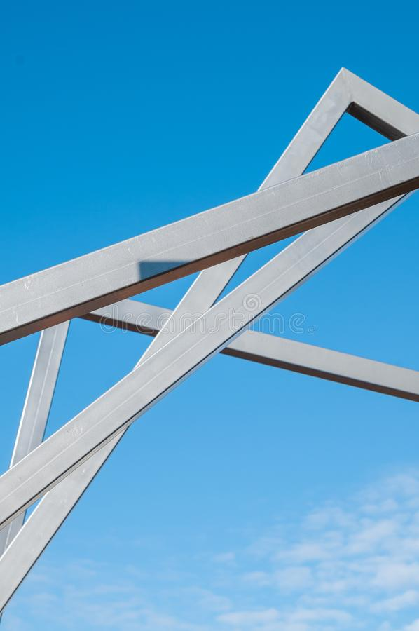 Metal art Line in the park. Sunny day, installation Modern Art, metal arcs in the park, province stock image