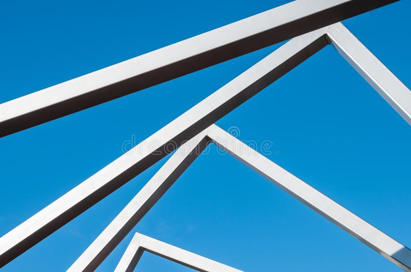 Metal art Line in the park. Sunny day, installation Modern Art, metal arcs in the park, province royalty free stock photos