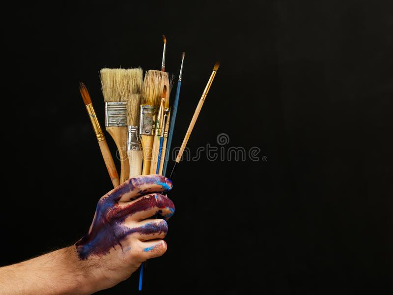 Modern art painter essential tools paintbrushes royalty free stock images