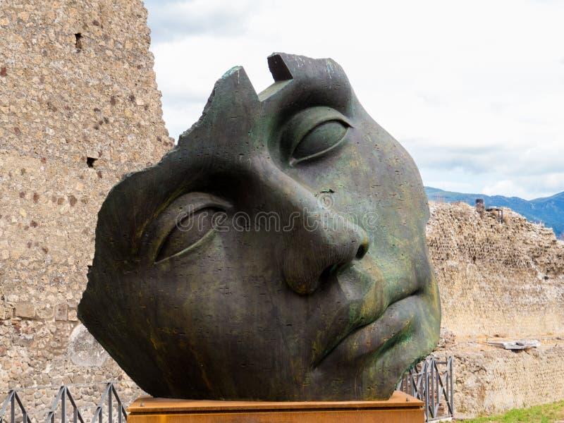 Modern art in Pompeii. Sculpture of the Polish sculptor Igor Mitoraj on display at Pompeii archaeological site, Campania, Italy stock photos
