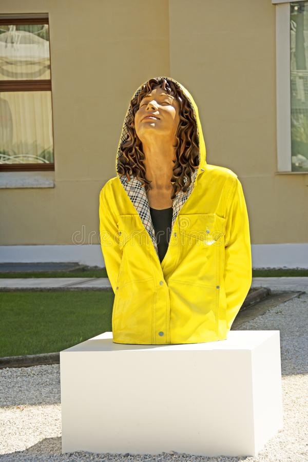 Modern art of a woman in a raincoat stock photo