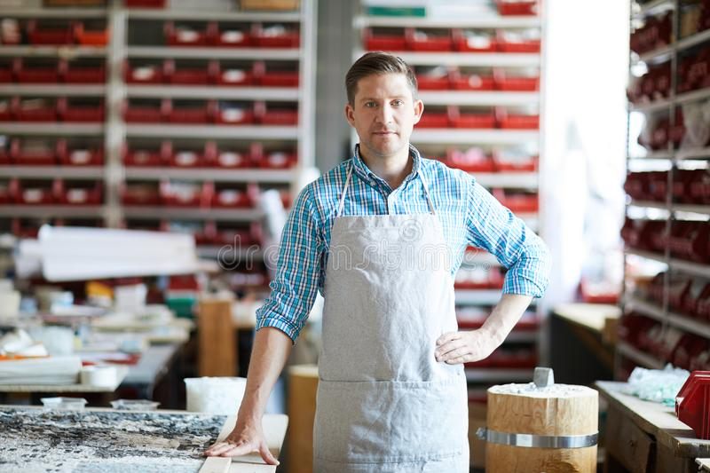 Modern Artisan Posing in Workshop stock images