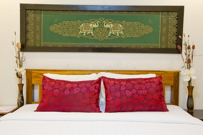 Modern Asian-style bed with nice silk screen with frame in bedroom- home interiors stock photo