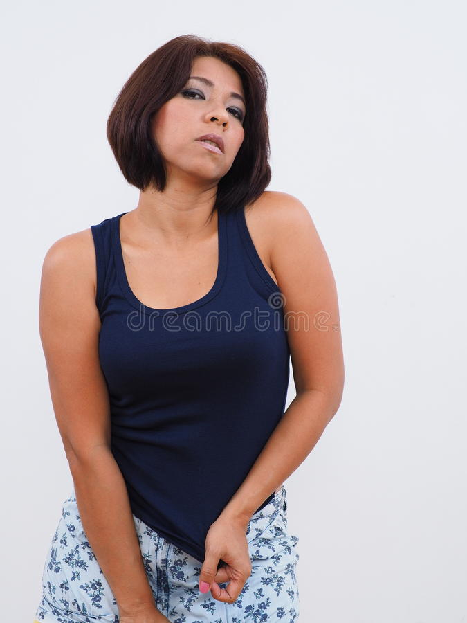 Modern Asian woman with blue tank top stock images