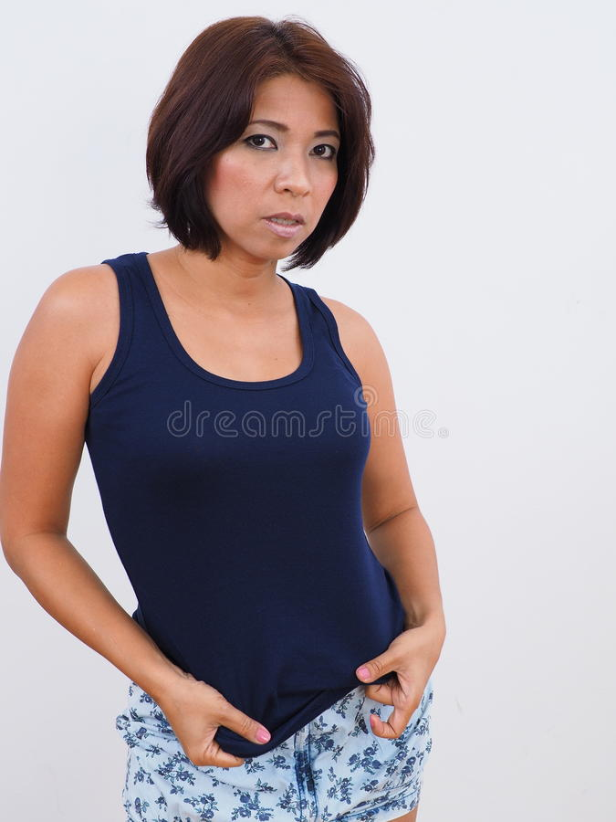 Modern Asian woman with blue tank top stock photo