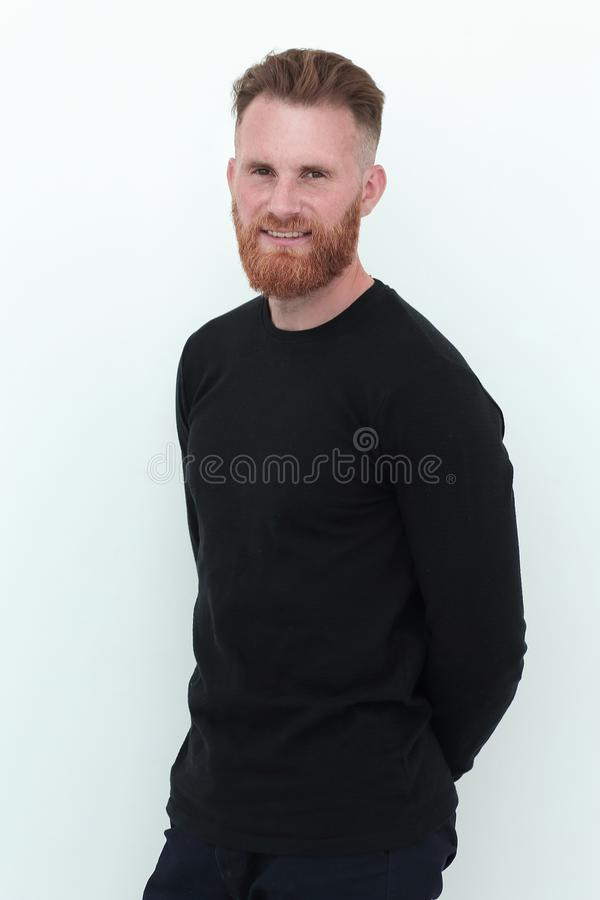 Modern attractive man in a black sweater. isolated on white stock image