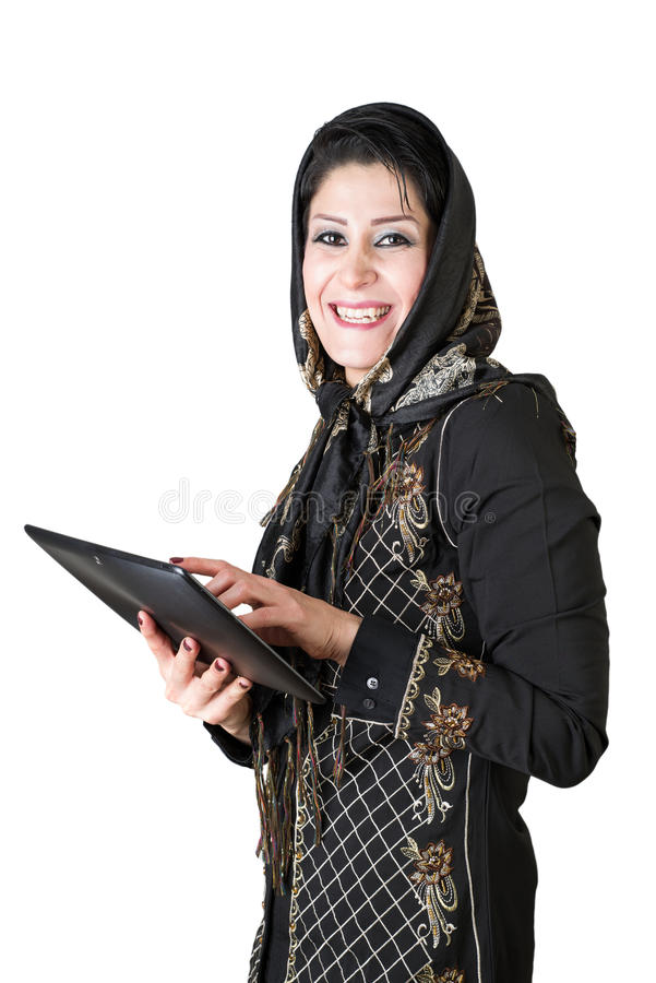 Modern attraktiv islamisk kvinna med minnestavlaPC arkivfoton