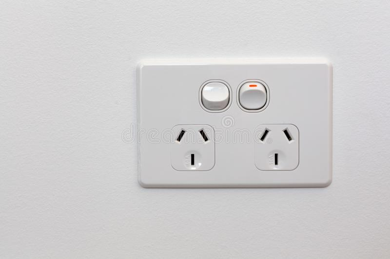 Double power outlet on white wall. stock image