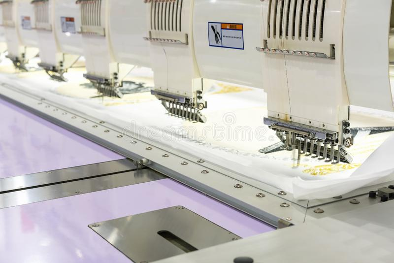 Modern and automatic high technology sewing machine for textile or clothing apparel making manufacturing process in industrial royalty free stock photos