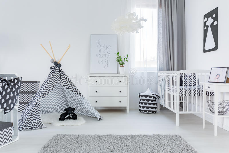 Modern baby room. With stylish, white furniture stock images