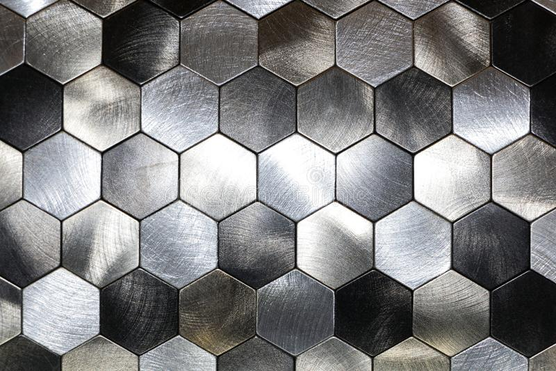 Modern background with a metal hexagons and a black outline. Macro shot.  stock image