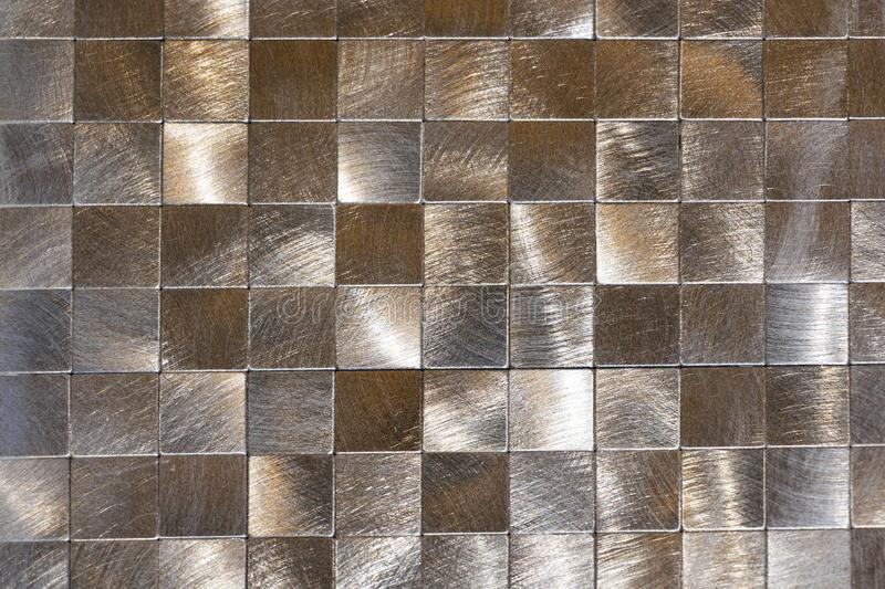 Modern background of metal pieces and a black outline. Macro shooting.  royalty free stock photography